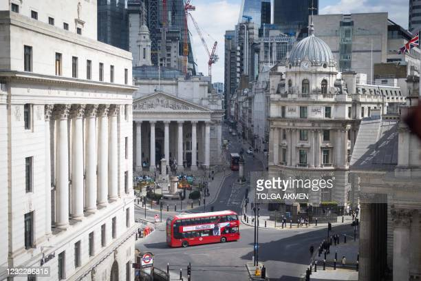 Double decker bus drives through the streets of the City of London, on April 13 as England continues to ease lockdown restrictions due to the...
