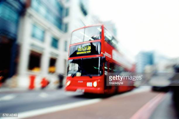 Double Decker bus moving on a road in London (blurred)