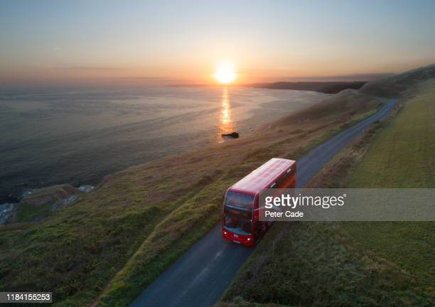 double decker bus on coastal road in cornwall - dramatic sky stock pictures, royalty-free photos & images