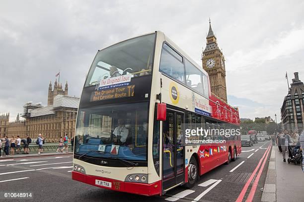 Double decker bus passing in front of Big Ben, London