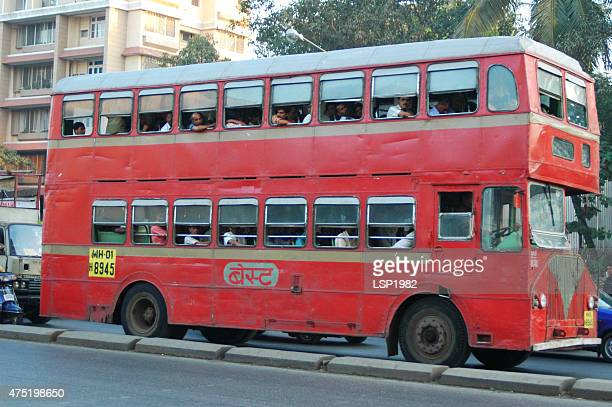 double decker red bus with people, mumbai, india. - double decker bus stock pictures, royalty-free photos & images