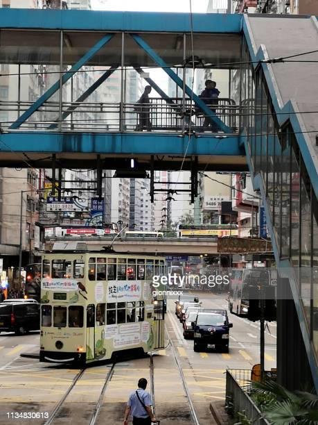 double decker tram riding in causeway bay, hong kong island - wanchai stock photos and pictures