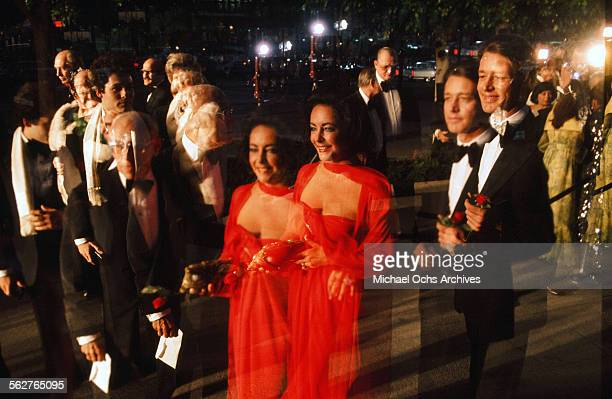 double exposure Actress Elizabeth Taylor arrives to the 48th Academy Awards at Dorothy Chandler Pavilion in Los AngelesCalifornia