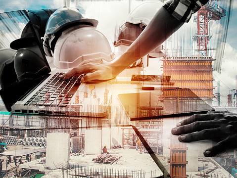 Double exposure architect working with laptop and blueprints in workplace for architectural plan,selective focus,Business concept 867395460