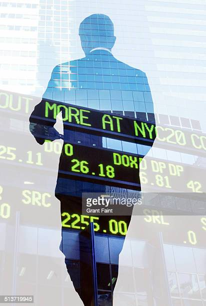 Double exposure: businessman and stock signboard