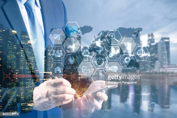 double exposure businessman hand working with digital tablet computer. business plan and technology networking concept - marketing icons stock photos and pictures