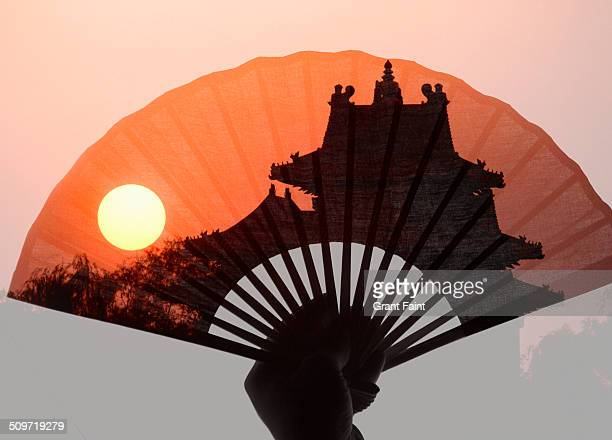 Double exposure: Chinese palace and fan.