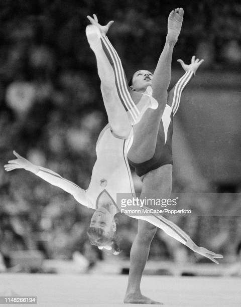 A double exposure featuring Nellie Kim performing in the women's floor final during the 1980 Summer Olympics at the Sports Palace of the Central...