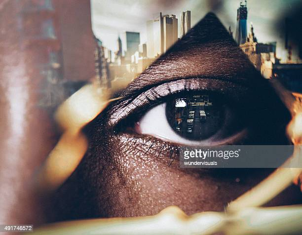 Double exposure image of a human eye with cityscape