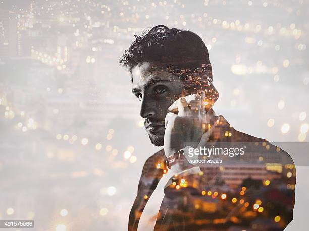 Double exposure image of businessman and city at night