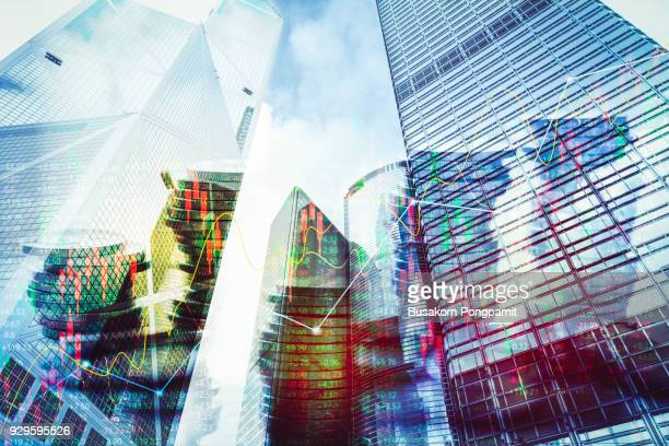 Double exposure image of coin on city with technology financial graph background.