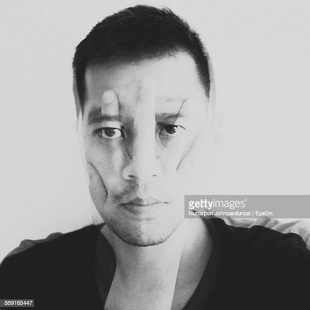 Double Exposure Image Of Man Covering Face With Hand At Home