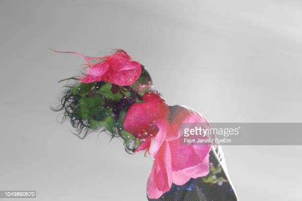double exposure image of woman and pink flowers against sky - digital composite stock pictures, royalty-free photos & images