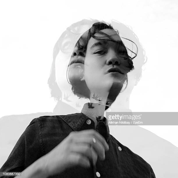double exposure image of young man against clear sky - multiple exposure stock pictures, royalty-free photos & images