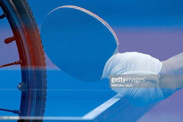 A double exposure image showing the wheelchair and bandaged hand of Kyung Mook Kim of Republic of Korea in the Men's Singles Table Tennis Class 2 on...