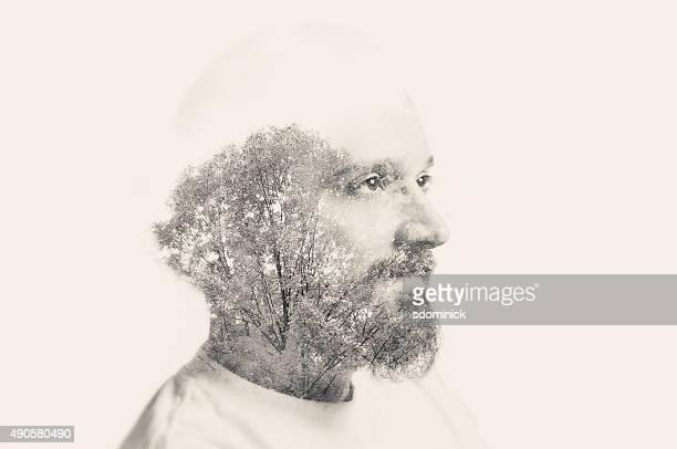 Double exposition homme avec barbe et arbres