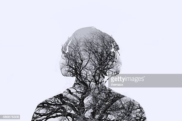 Double exposure man with tree in the portrait