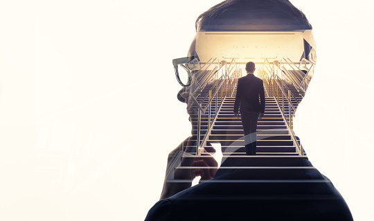 Double exposure of a businessman and stairs. Success of business concept. 994786356