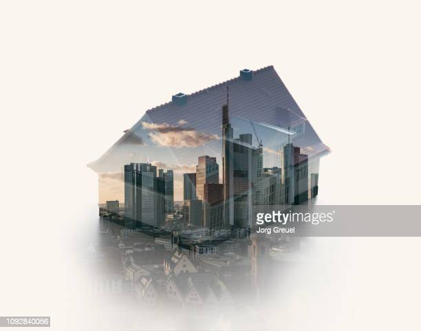 double exposure of a house model and an urban skyline - デジタル合成 ストックフォトと画像