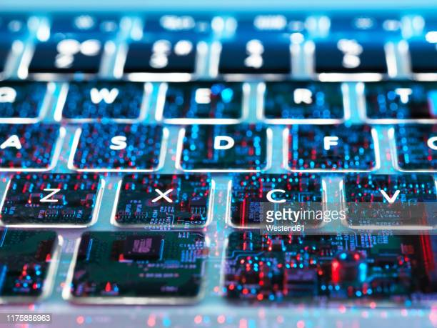 double exposure of a laptop computer showing electronic components under the keyboard - encryption stock pictures, royalty-free photos & images