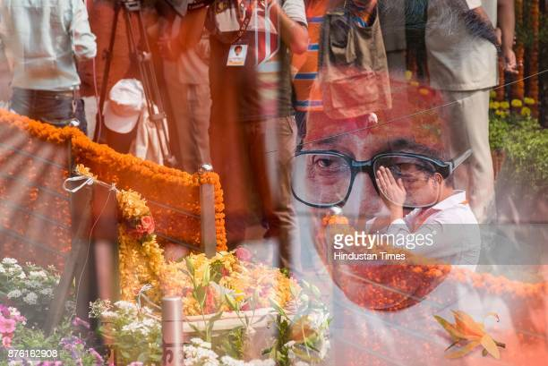Double exposure of A man pays respect on the occasion of fifth death anniversary of the Late Balasaheb Thackeray at his memorial at Shivaji Park...