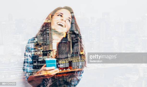 Double exposure of a  woman using a smart phone