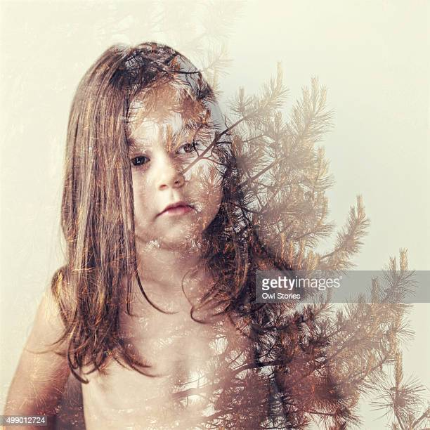 double exposure of a young child and a tree - bottomless girls stock photos and pictures