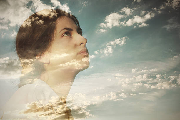 Double Exposure Of A Young Woman And Cloudy Sky Wall Art