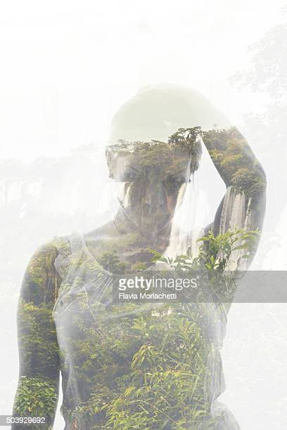Double exposure of a young woman and Iguazú Waterfalls