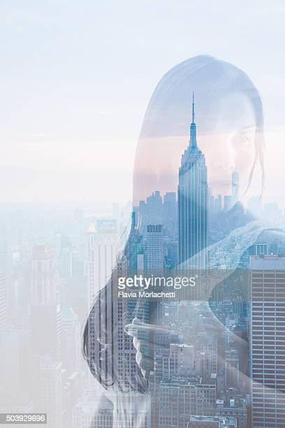 Double exposure of a young woman and New York City