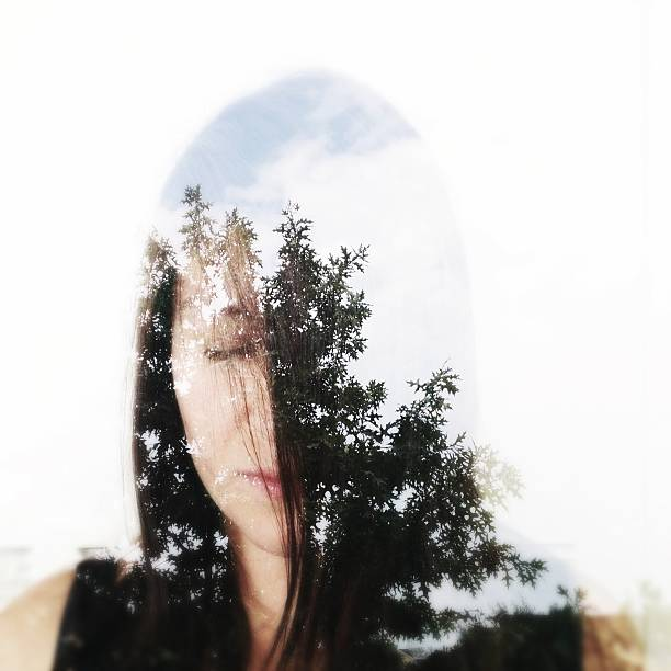 Double Exposure Of A Young Woman And Trees Wall Art