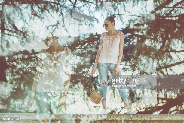 Double exposure of a young woman and trees