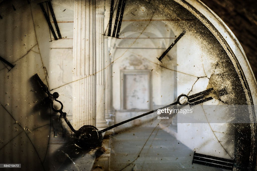 Double exposure of antique pocket watch and old architecture : Stock Photo