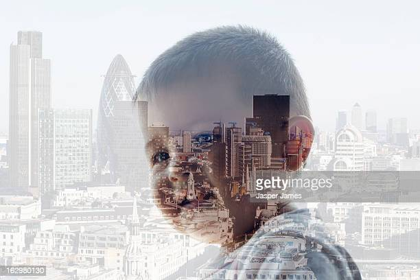 double exposure of baby and cityscape - 2010 stock pictures, royalty-free photos & images
