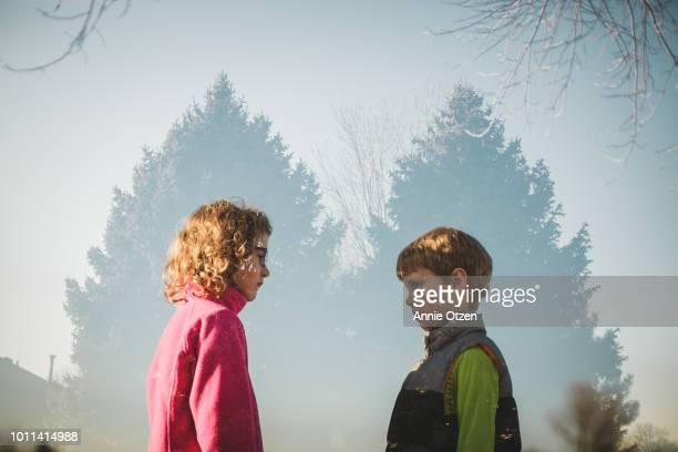 Double exposure of boy and girl