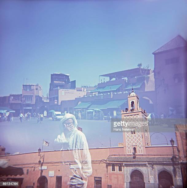 Double exposure of buildings and people in a city, Marrakesh, Morocco