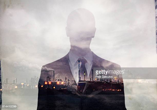 double exposure of businessman and power plant - 人の姿 ストックフォトと画像