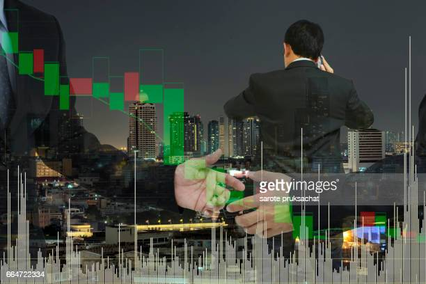 Double exposure of   Businessman groups hand shake for business and technical bar chart  background.