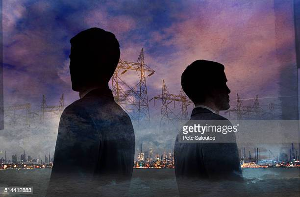 Double exposure of businessmen and power lines