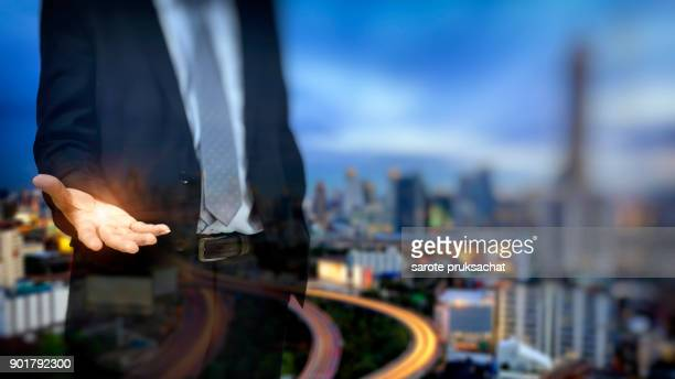 Double exposure of Businessmen with open hands ready to run a business and blurred city background .Concept for business, finance .