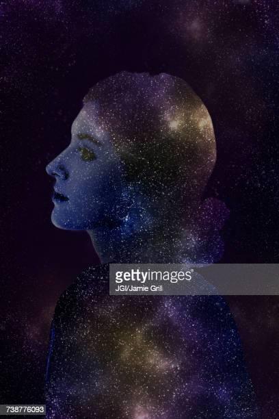 double exposure of caucasian woman and stars in outer space - filosofía fotografías e imágenes de stock