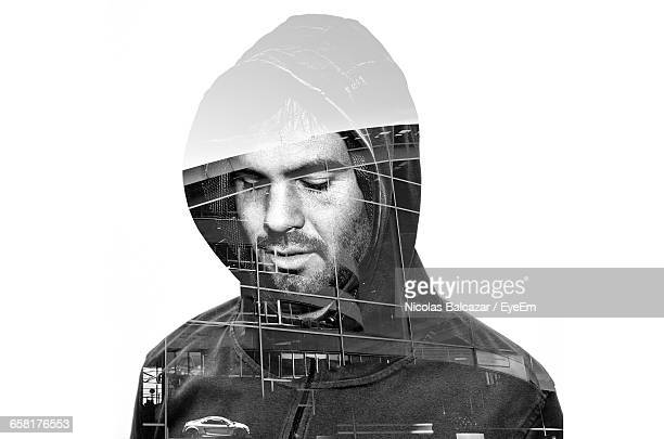 Double Exposure Of City On Man Against White Background
