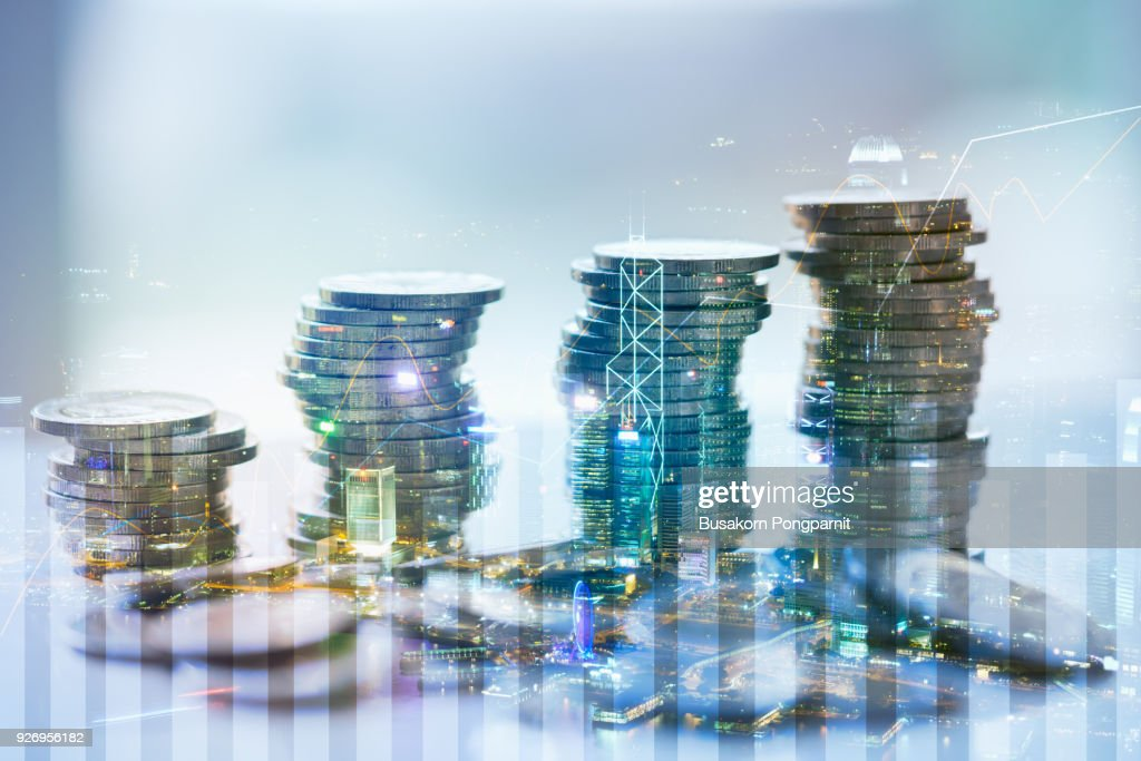 Double exposure of city with graph and stack of coins for finance and business concept : Foto de stock