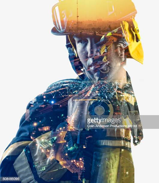 Double exposure of cityscape and fire fighter
