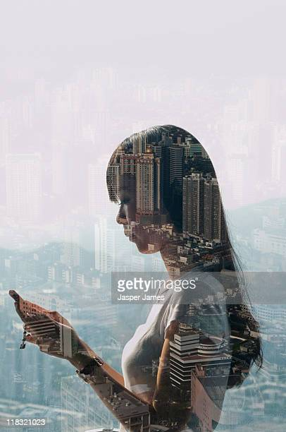 double exposure of cityscape and girl using mobile - erin james stock-fotos und bilder