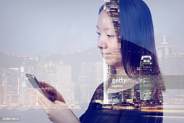 Double exposure of cityscape and smart phone