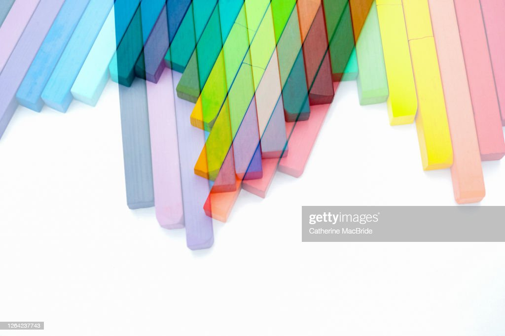 Double exposure of colourful  chalk pastels in an Overlocking Pattern : Stock Photo