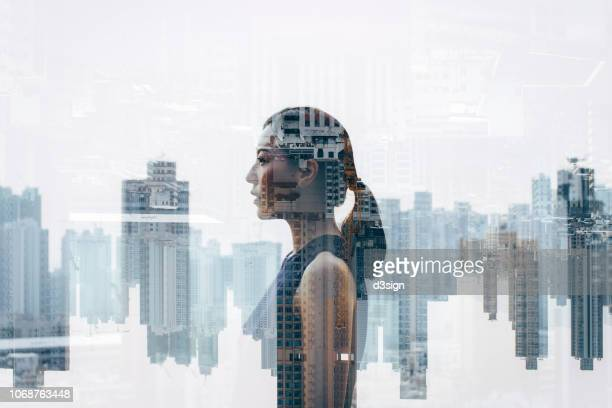 double exposure of confidence businesswoman over urban cityscape - mehrfachbelichtung stock-fotos und bilder