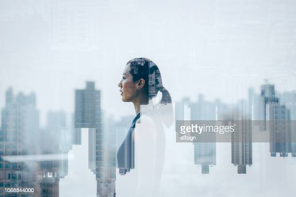 double exposure of confidence young asian woman over cityscape - 多重露出 ストックフォトと画像
