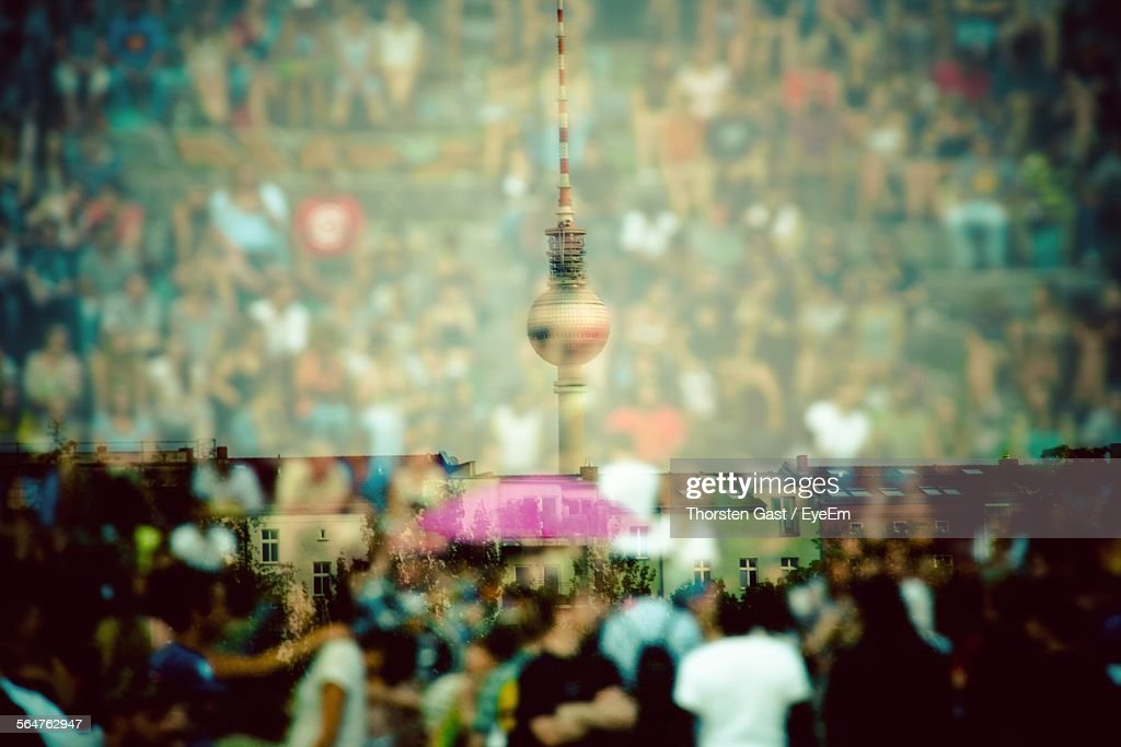 Double Exposure Of Crowd And Communications Tower : Stock Photo